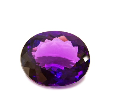 Single violet amethyst gem on white background Stock Photo