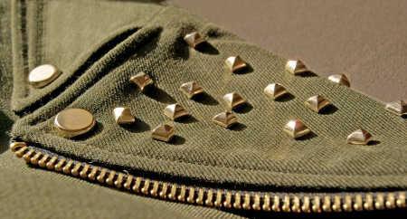 Woman Jacket detail with golden metal spikes, swag style