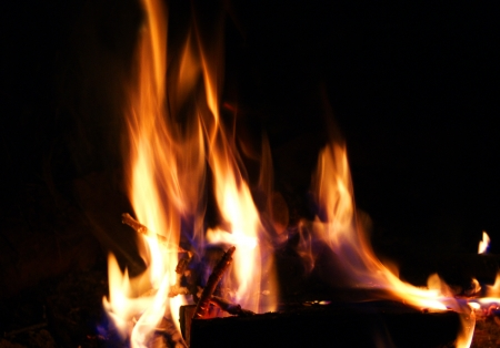 Red coals and fire in the fireplace