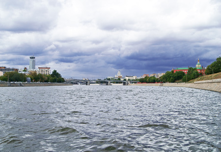Panoramic view on bridge across Moscow river on a cloudy day