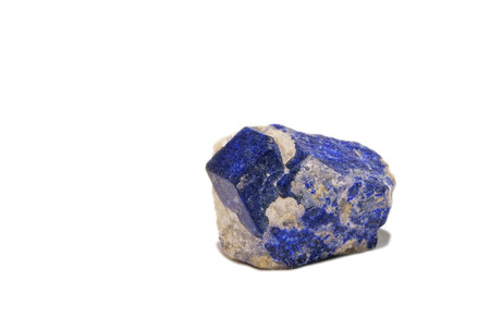 Rare blue cubic lazurite crystal with phlogopite in calciphyre Stock Photo