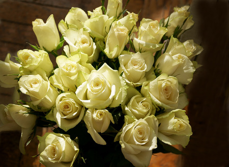 Large bunch of greenish white roses with sun light