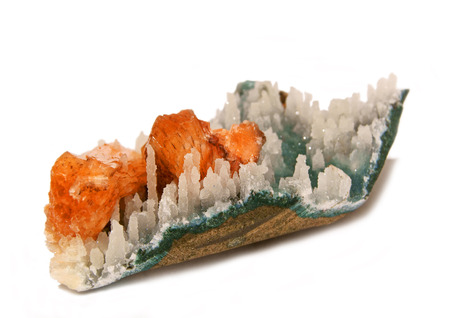 Orange stillbirth crystals on chalcedony stalactite matrix