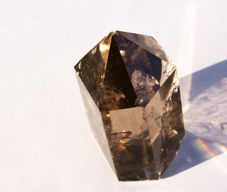 A Smoky Quartz Crystal in natural sunlight with a rainbow from Hallelujah Junction NV USA