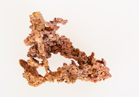 Piece of native shapeless copper on white background