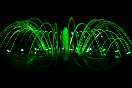 Close view details of the fountain at night, green lighting decoration Stock Photo
