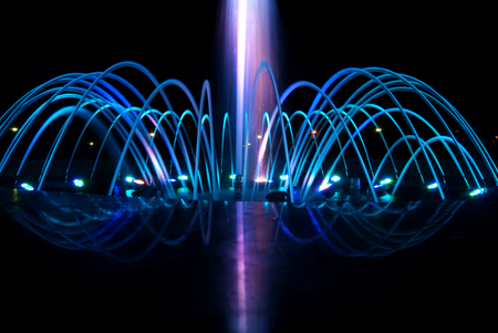 Close view details of the fountain at night, blue lighting decoration