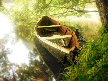 serene landscape: Landscape with wooden boat in early sunrise light Stock Photo