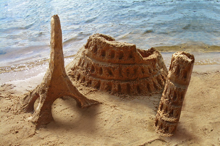 Travel around the world. Famous landmarks made of sand - Coliseum, Eiffel tower, Pisa tower