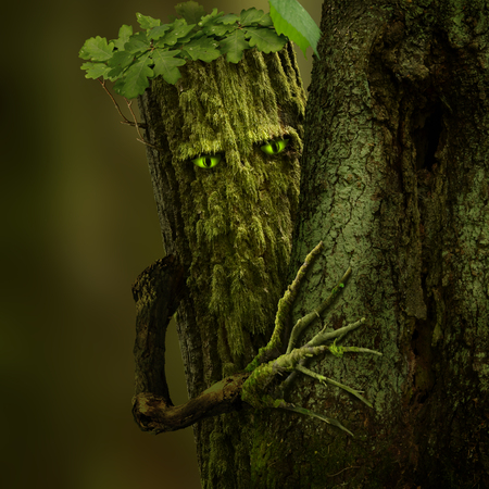 Forest Green Man. Celtic Fantasy character as a mossy tree with green eyes and branch hand
