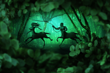 Centaurs couple (male and female) running through green fabulous fairy tale fantasy forest. 写真素材