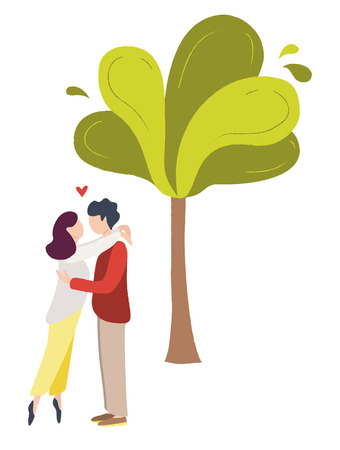 A couple of young people staying  in a park. A pair of man and woman in love near the tree.