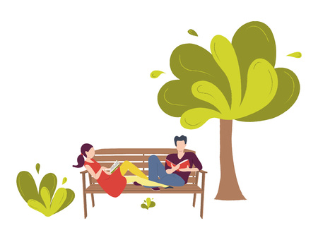 A pair of young people sitting on a bench in a park. A couple of a man and a woman in love reading books.