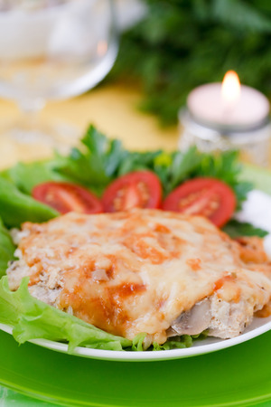Baked meat with mushrooms and bechamel sauce