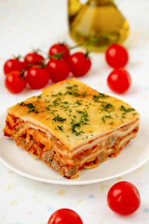 Italian lasagna with meat and tomatoes  Macro  Stock Photo
