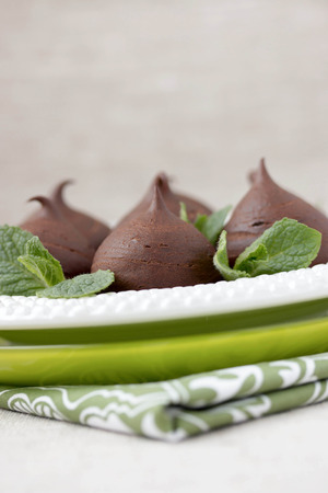 Chocolate profiteroles with cottage  Vertical photo  Macro