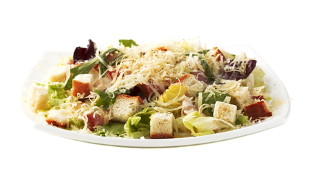 Caesar salad. On a white background. Isolated photo.