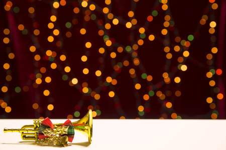 happy christmas and new year concept_ golden trumpet on the bokeh background & space for text. Stock Photo