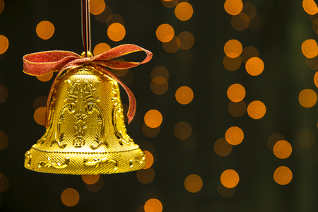 christmas bell on the bokeh background.