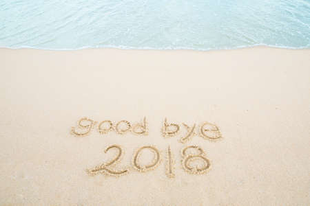 good bye 2018 written on the sand beach. Stock Photo