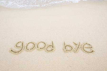 good bye written on the beach.