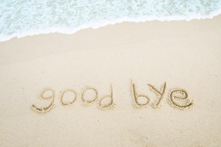 text_good bye written on the beach