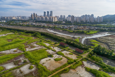 red old houses in wetland near city, Incheon, Korea. Stock Photo