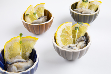 lemon slices and oysters.
