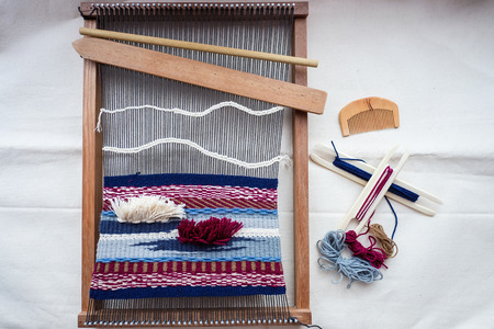 weaving: topview of tools and thread for weaving, hand loom for weaving