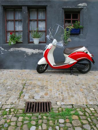 nostalgy: Trendy moped against old building. Fribourg, Switzerland