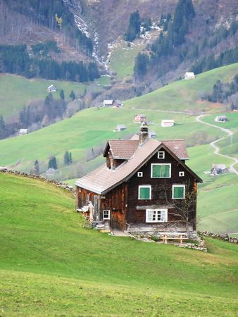 Traditional wooden house in Arvenbuehl photo