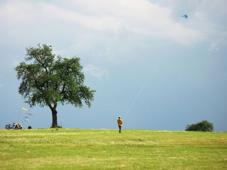 Flying a kite in stormy sky photo