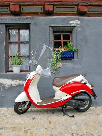 Trendy moped against old building. Fribourg, Switzerland  photo