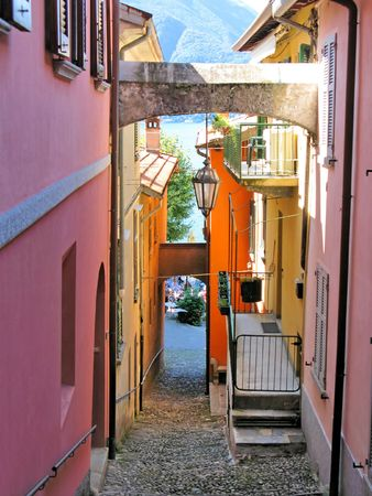 Narrow street of Varenna town at the lake Como, Italy photo