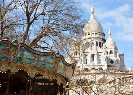 lifelike: Old carousel and Basilique Sacre Coeur in Paris Stock Photo