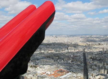 Binoculars against aerial panorama of Paris photo