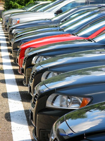car dealers: Row of cars