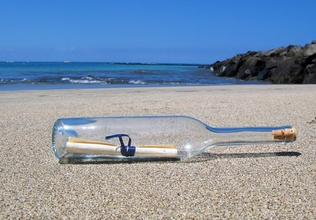 Bottle with a message on the desert beach of Tenerife island. photo