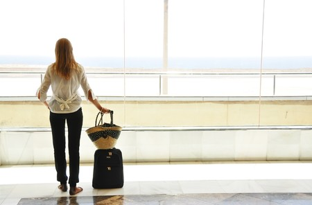 Girl at the airport looking to the ocean
