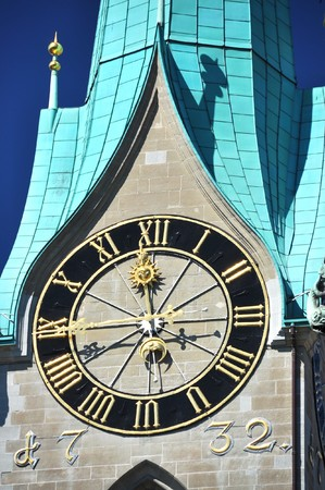 singularity: Ancient clock on top of Fraumunster church in Zurich Stock Photo