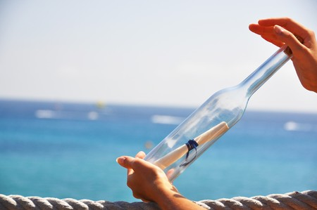 Bottle with a message in the hands Stock Photo - 8036833