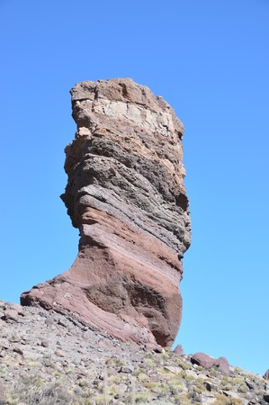rockslide: The famous Finger Of God rock formation and Teide volcano. Tenerife island, Canaries