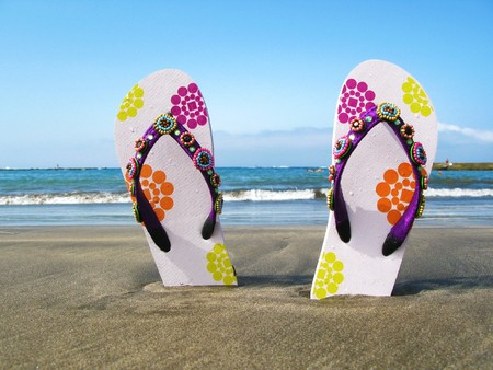 Flip-flops in the black volcanic sand of Tenerife island, Canaries Stock Photo
