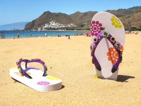 Flip-flops in the sand of Teresitas beach. Tenerife island, Canaries  photo