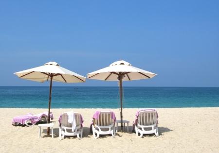 parasols: Sun umbrellas and chairs on the Bang Tao beach of Phuket island  Stock Photo
