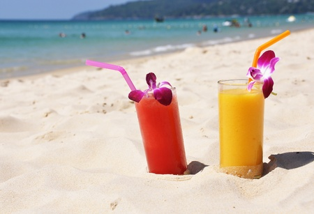 Pair of fruit shakes on the tropical beach  photo