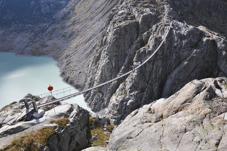 Trift Bridge, the longest 170m pedestrian-only suspension bridge in the Alps. Switzerland