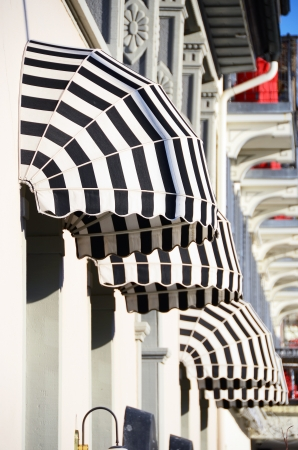 Striped awnings of a restaurant  Stock Photo