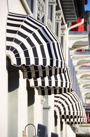 Striped awnings of a restaurant  Reklamní fotografie