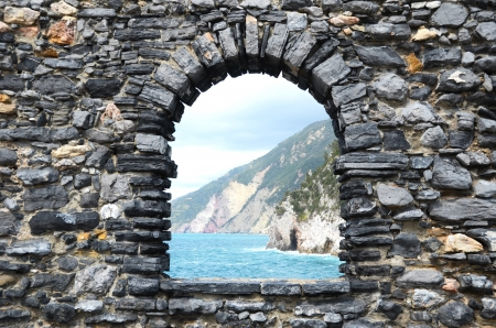 view through: Ligurian coast  View from the old fortress in Portovenere town, Italy  Stock Photo